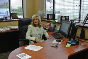 Mary Kaye Bredeson at her desk, photo